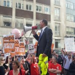 NAPO General Secretary Ian Lawrence rallies the crowd outside the Ministry of Justice