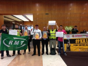Members of RMT and NSSN on solidarity protest at Shell in Canary Wharf